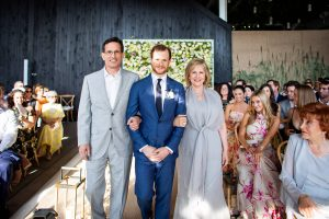 Groom with parents during ceremony at this Hamptons wedding weekend held at The Parrish Museum | Photo by Roey Yohai Studio