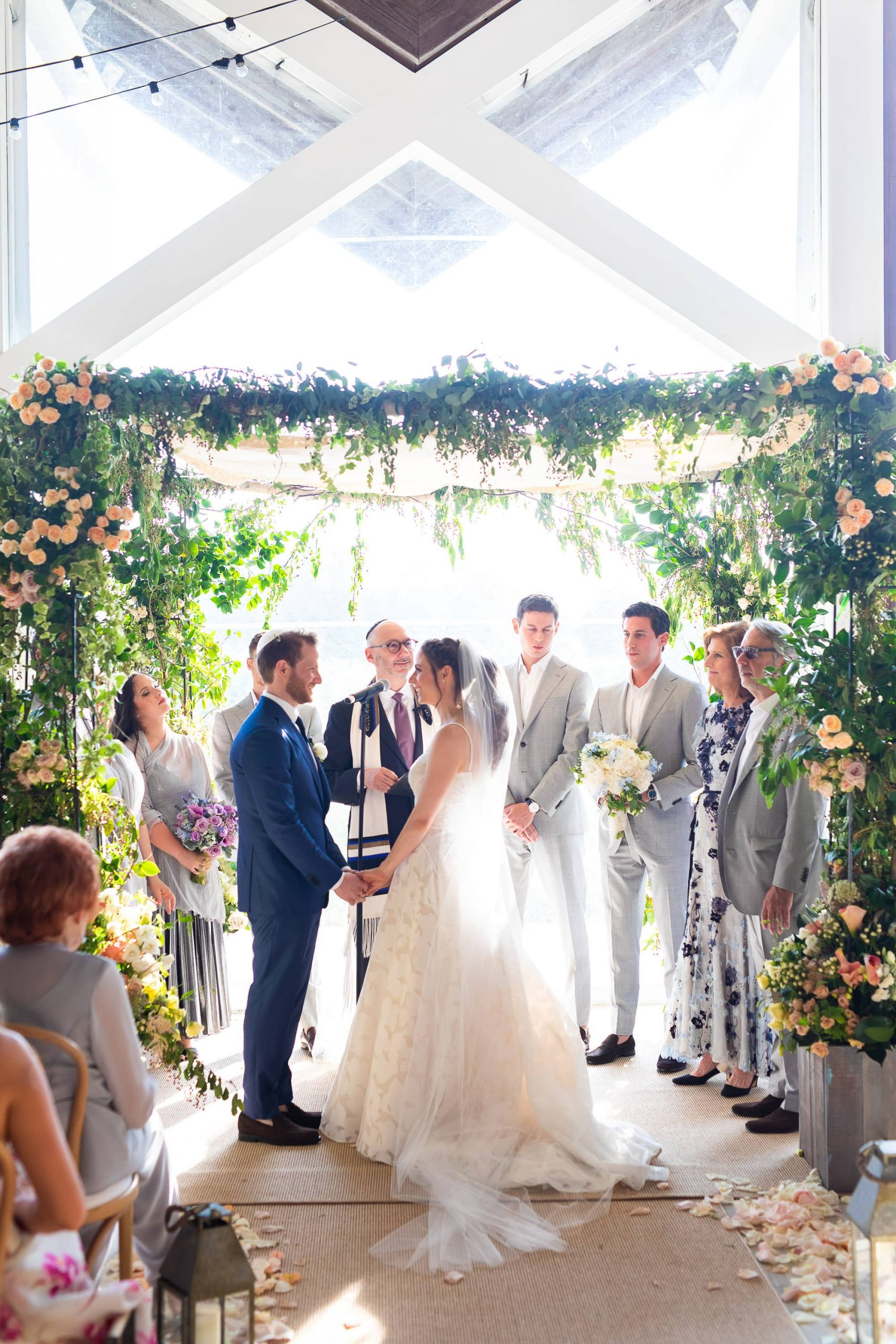Bride and groom at Jewish ceremony at this Hamptons wedding weekend held at The Parrish Museum | Photo by Roey Yohai Studio