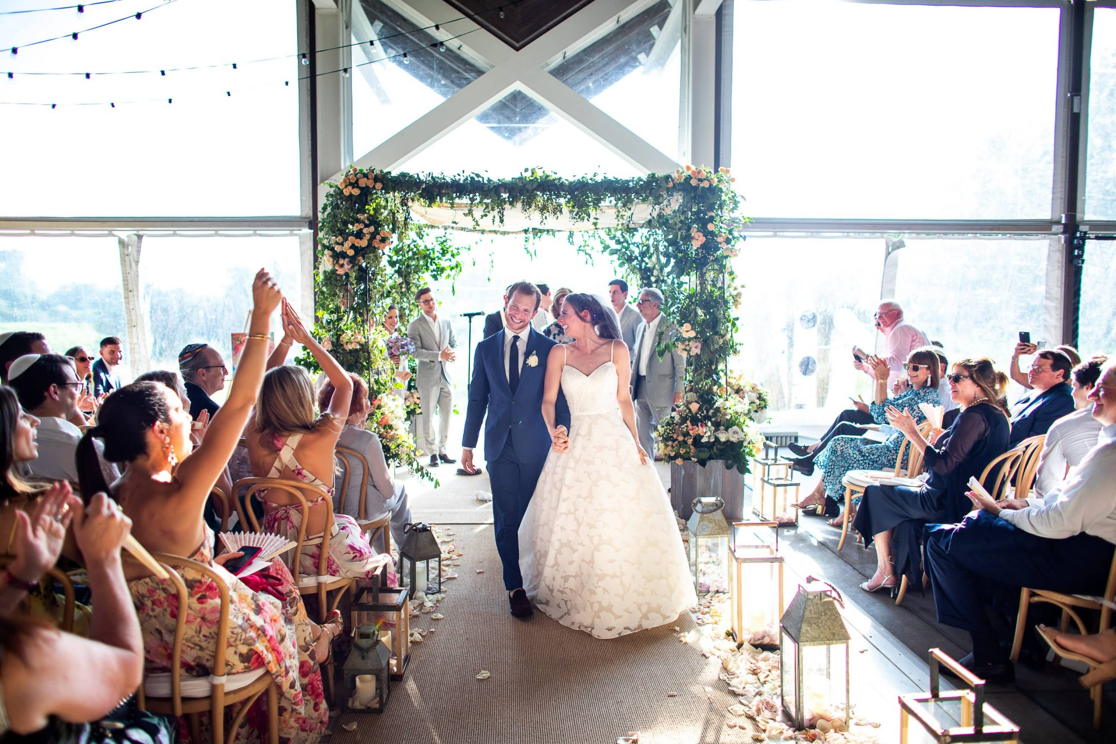 Newlyweds at Jewish ceremony at this Hamptons wedding weekend held at The Parrish Museum | Photo by Roey Yohai Studio