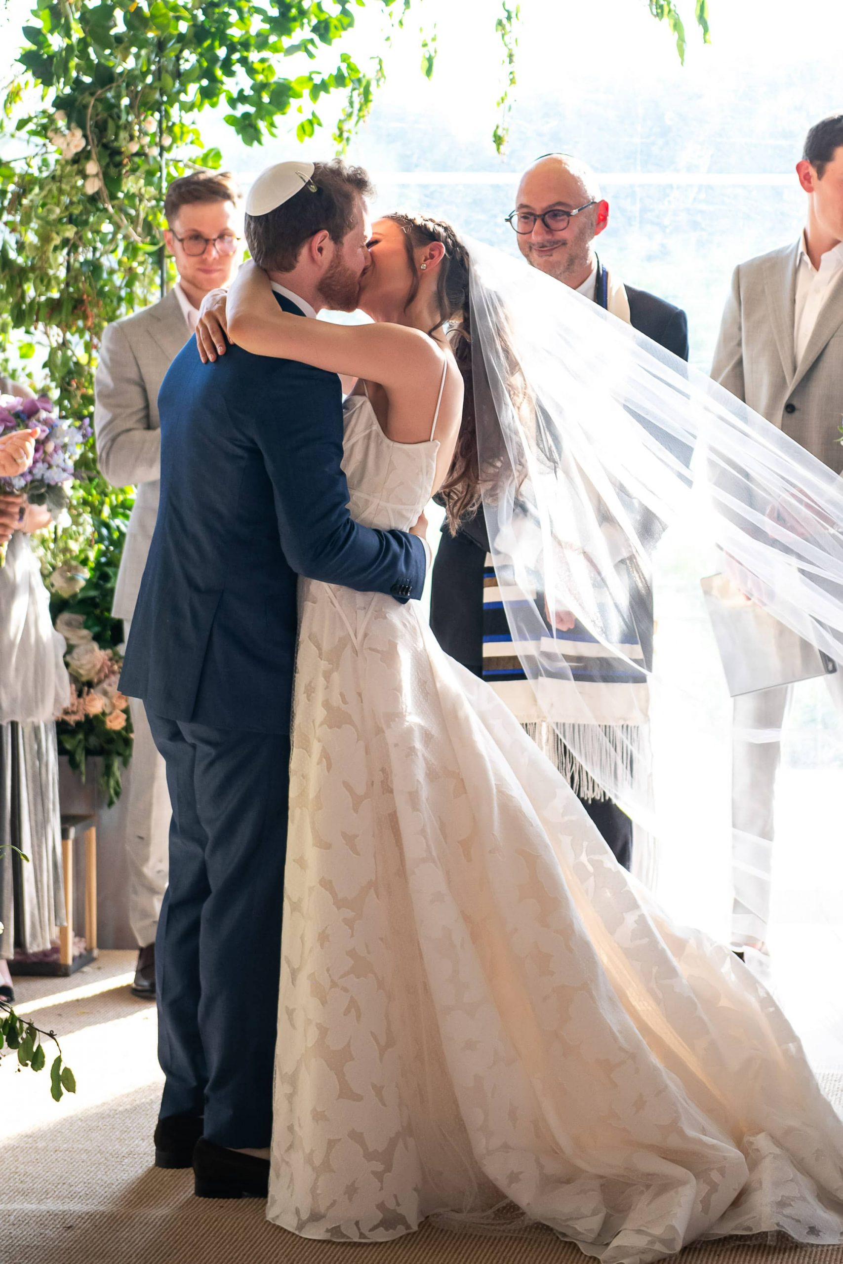 Newlyweds kissing at this Hamptons wedding weekend held at The Parrish Museum | Photo by Roey Yohai Studio