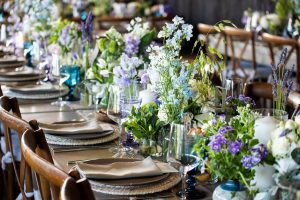 Table and floral decor at this Hamptons wedding weekend held at The Parrish Museum   Photo by Roey Yohai Studio