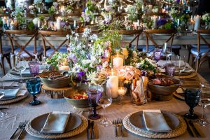 Reception floral table decor at this Hamptons wedding weekend held at The Parrish Museum | Photo by Roey Yohai Studio