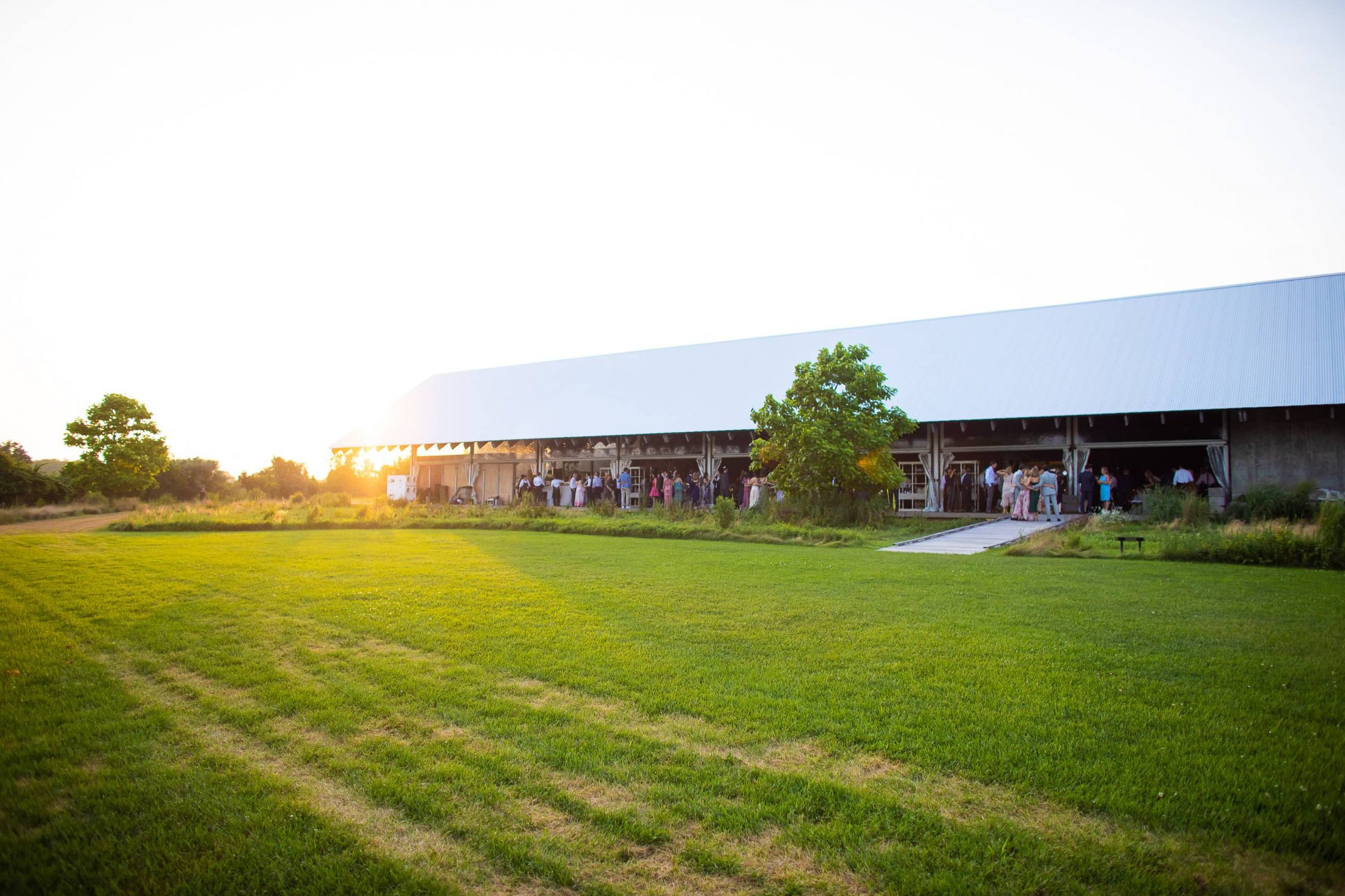 Sunset over reception at this Hamptons wedding weekend held at The Parrish Museum | Photo by Roey Yohai Studio