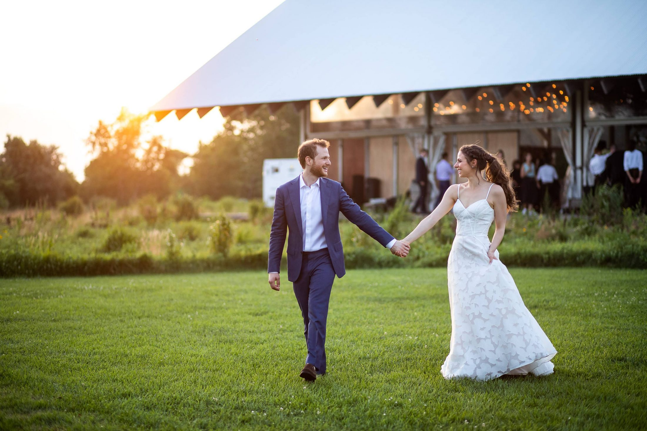 Bride and groom at reception at this Hamptons wedding weekend held at The Parrish Museum | Photo by Roey Yohai Studio