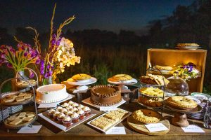 Dessert table of pies and cakes at this Hamptons wedding weekend held at The Parrish Museum | Photo by Roey Yohai Studio