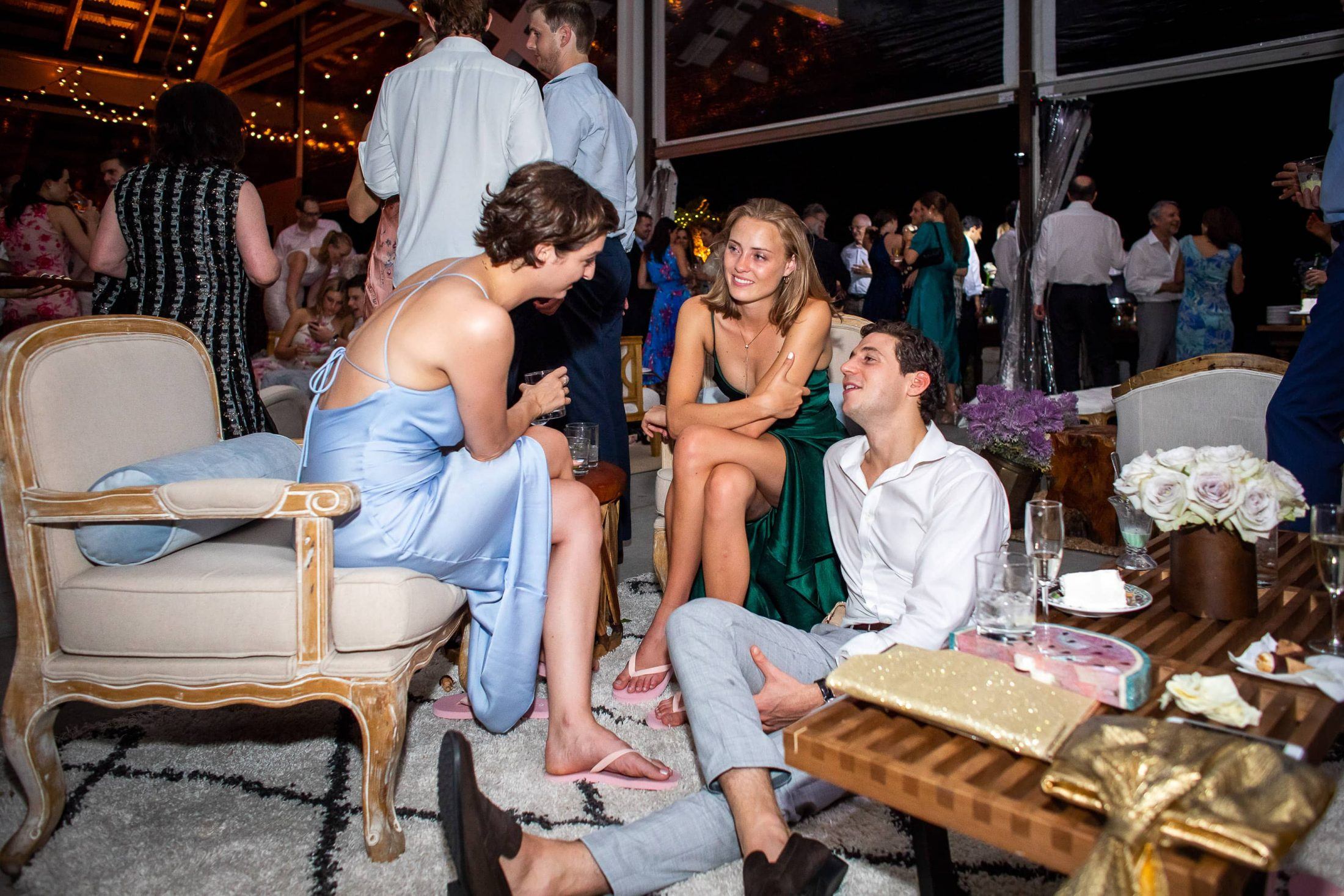 Guests with complimentary flip-flops during reception at this Hamptons wedding weekend held at The Parrish Museum | Photo by Roey Yohai Studio