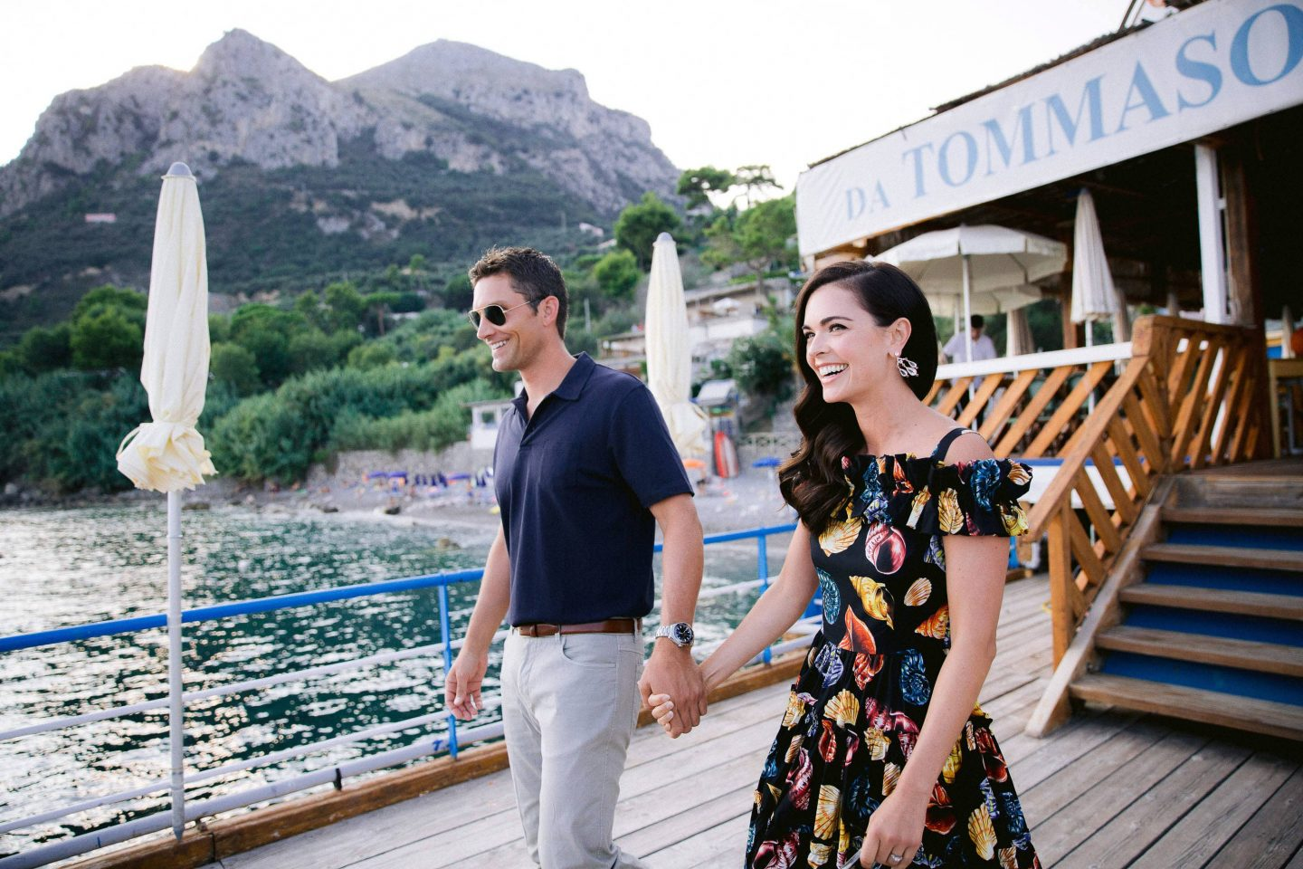 Bride and groom on sunset sail to Capri at this Amalfi Coast wedding weekend held Lo Scoglio | Photo by Allan Zepeda