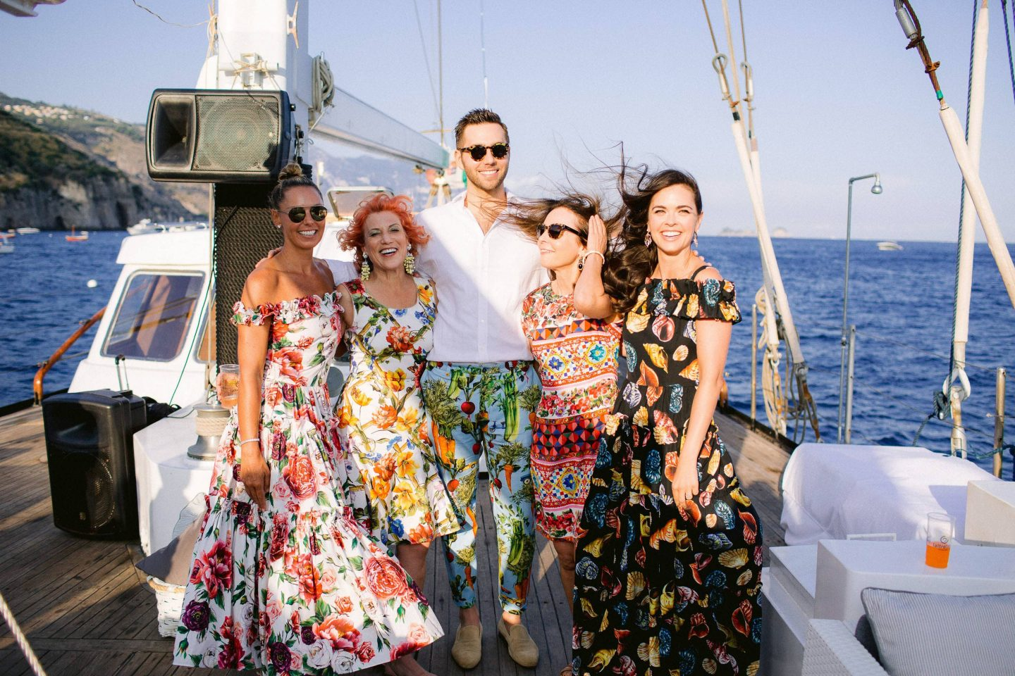 Wedding guests during sunset sail to Capri at this Amalfi Coast wedding weekend held Lo Scoglio | Photo by Allan Zepeda