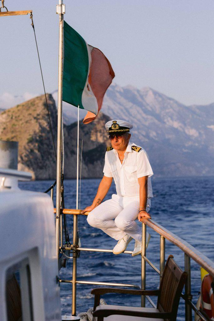 Captain of the sail to Capri at this Amalfi Coast wedding weekend held Lo Scoglio | Photo by Allan Zepeda
