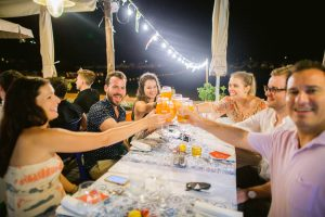 Cheers during the evening pizza party at this Amalfi Coast wedding weekend held Lo Scoglio | Photo by Allan Zepeda