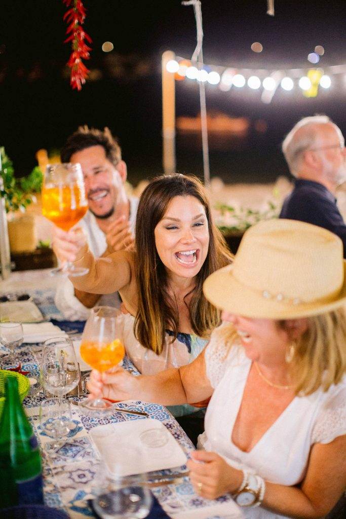 Guests at evening pizza party at this Amalfi Coast wedding weekend held Lo Scoglio | Photo by Allan Zepeda