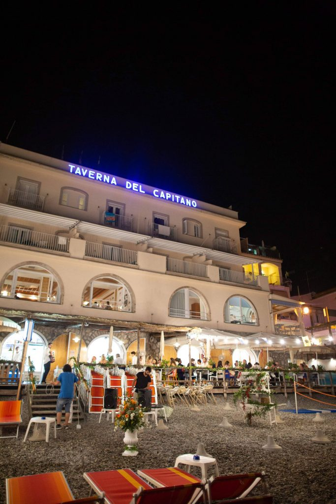 Taverna del Capitano and beach at night at this Amalfi Coast wedding weekend held Lo Scoglio | Photo by Allan Zepeda