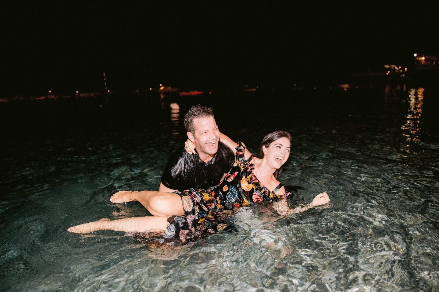 Bride and groom in the water at night at this Amalfi Coast wedding weekend held Lo Scoglio | Photo by Allan Zepeda
