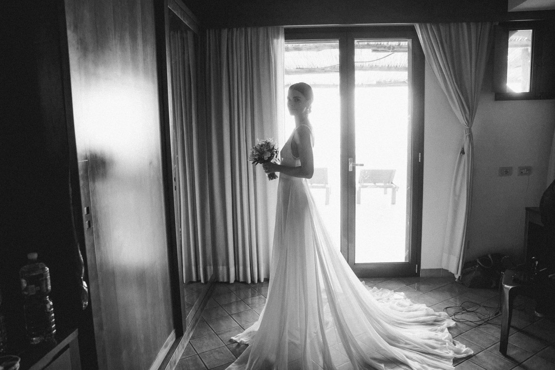 Bride at this Amalfi Coast wedding weekend held Lo Scoglio | Photo by Allan Zepeda