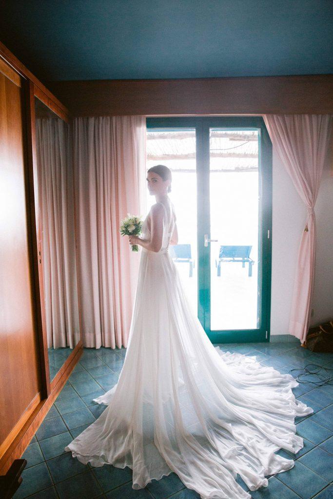 Bride's dress at this Amalfi Coast wedding weekend held Lo Scoglio | Photo by Allan Zepeda