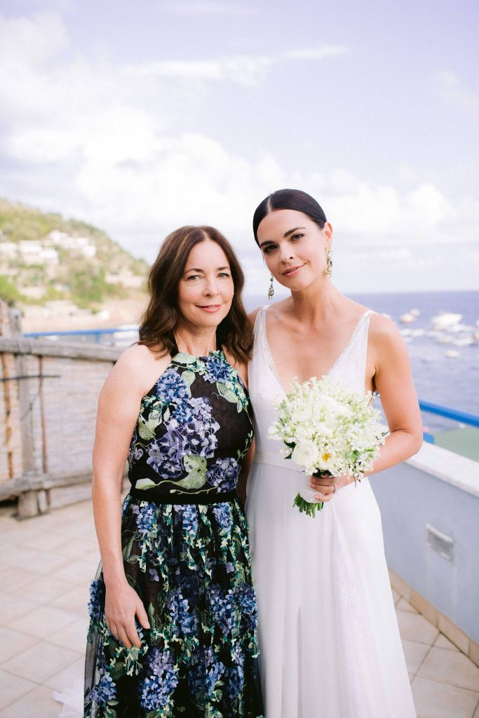Bride and guest at this Amalfi Coast wedding weekend held Lo Scoglio | Photo by Allan Zepeda