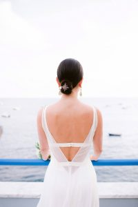 Bride's wedding dress back at this Amalfi Coast wedding weekend held Lo Scoglio | Photo by Allan Zepeda
