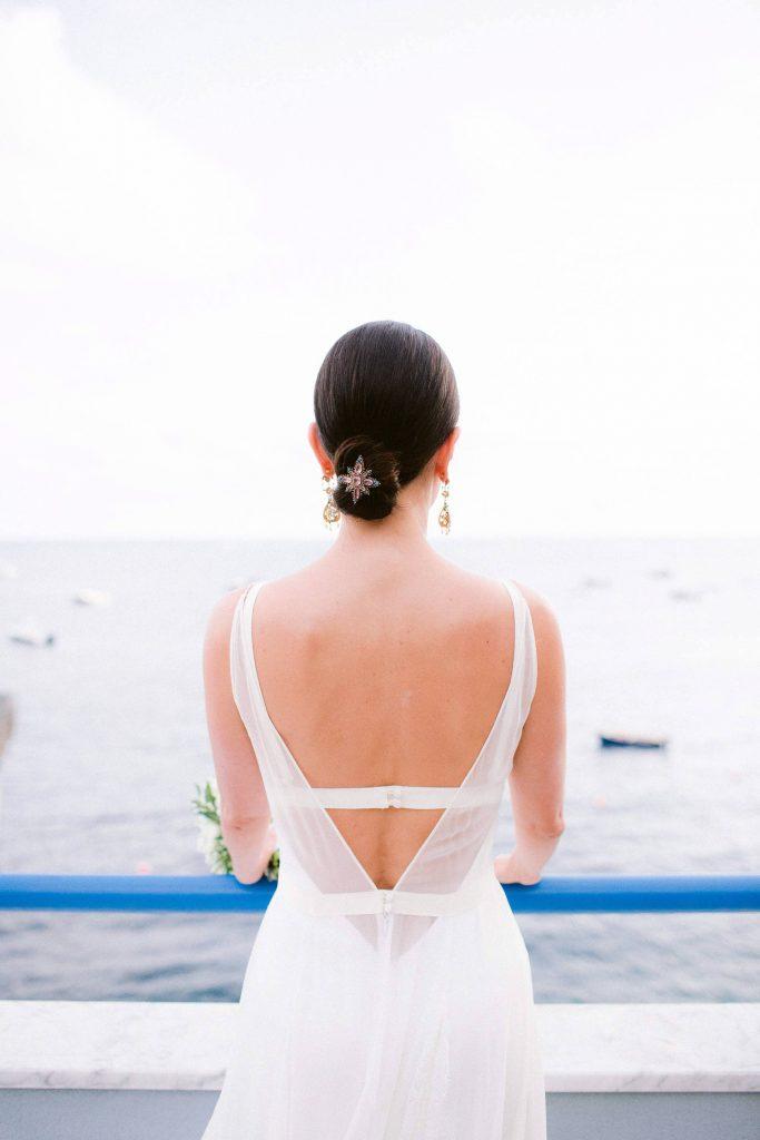 Bride's wedding dress back at this Amalfi Coast wedding weekend held Lo Scoglio | Photo by Allan Zepeda