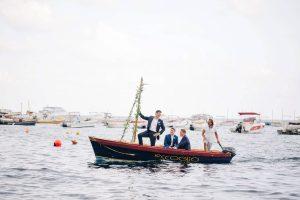 Groomsmen coming by boat at this Amalfi Coast wedding weekend held Lo Scoglio   Photo by Allan Zepeda