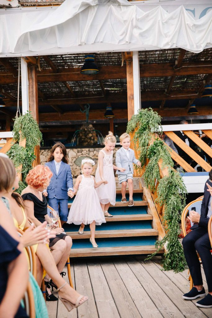 Children before the ceremony at this Amalfi Coast wedding weekend held Lo Scoglio | Photo by Allan Zepeda