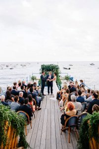 The ceremony at Lo Scolgio's deck overlooking the sea at this Amalfi Coast wedding weekend | Photo by Allan Zepeda