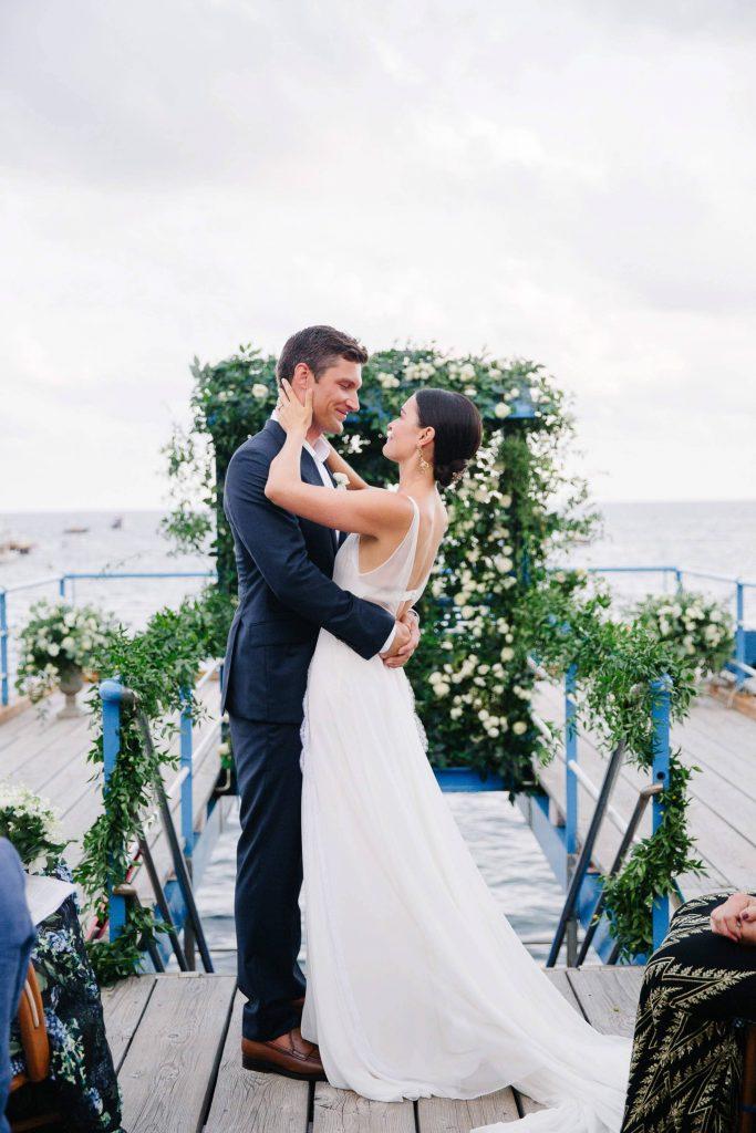 Bride and groom during ceremony at this Amalfi Coast wedding weekend held Lo Scoglio | Photo by Allan Zepeda