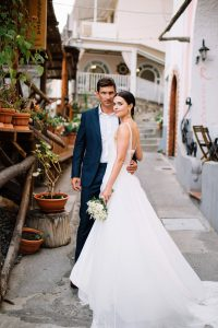 Bride and groom at this Amalfi Coast wedding weekend held Lo Scoglio | Photo by Allan Zepeda