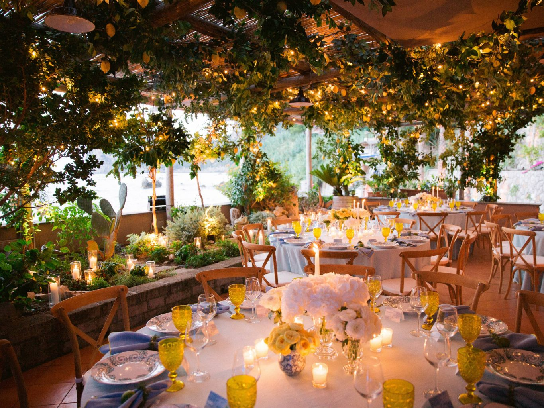 Lemon grove reception and floral decor at this Amalfi Coast wedding weekend held Lo Scoglio | Photo by Allan Zepeda