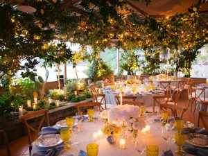 Lemon grove reception and floral decor at this Amalfi Coast wedding weekend held Lo Scoglio | Photo by Allan Zepeda