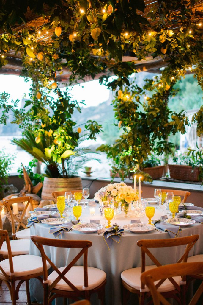 Lemon grove reception table and floral decor at this Amalfi Coast wedding weekend held Lo Scoglio | Photo by Allan Zepeda