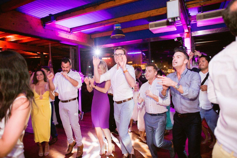Guests dancing during reception at this Amalfi Coast wedding weekend held Lo Scoglio | Photo by Allan Zepeda