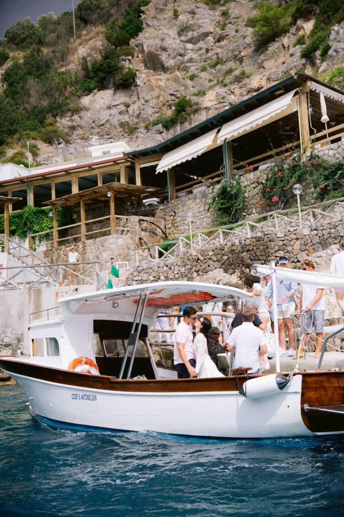 Beach party near Conca del Sogno at this Amalfi Coast wedding weekend held Lo Scoglio | Photo by Allan Zepeda