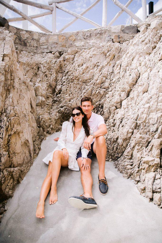 Bride and groom during beach party near Conca del Sogno beach club at this Amalfi Coast wedding weekend held Lo Scoglio | Photo by Allan Zepeda