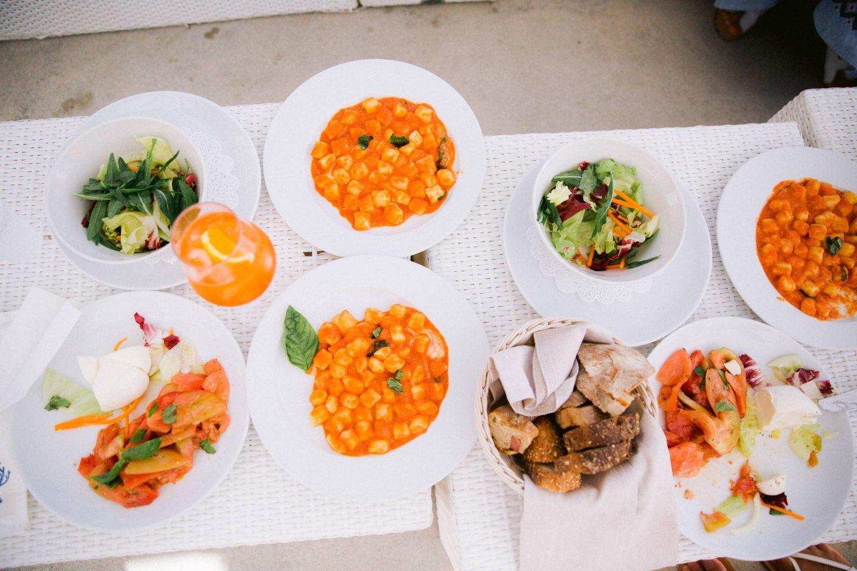 Gnocchi lunch at beach party near Conca del Sogno beach club at this Amalfi Coast wedding weekend held Lo Scoglio | Photo by Allan Zepeda