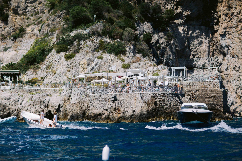Beach party near Conca del Sogno beach club at this Amalfi Coast wedding weekend held Lo Scoglio | Photo by Allan Zepeda