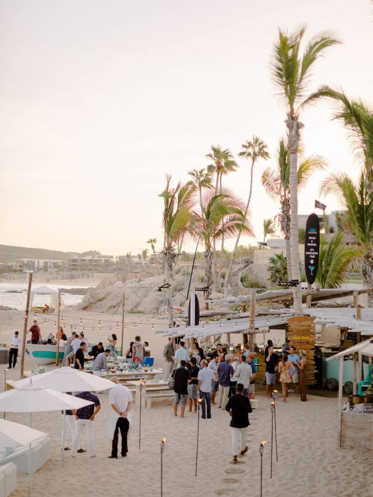 Guests on the beach at this Los Cabos wedding in Mexico | Photo by Allan Zepeda