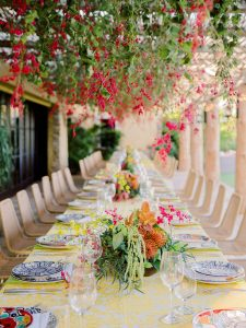 Colorful tablescape with hanging flowers for reception at this Los Cabos wedding in Mexico | Photo by Allan Zepeda