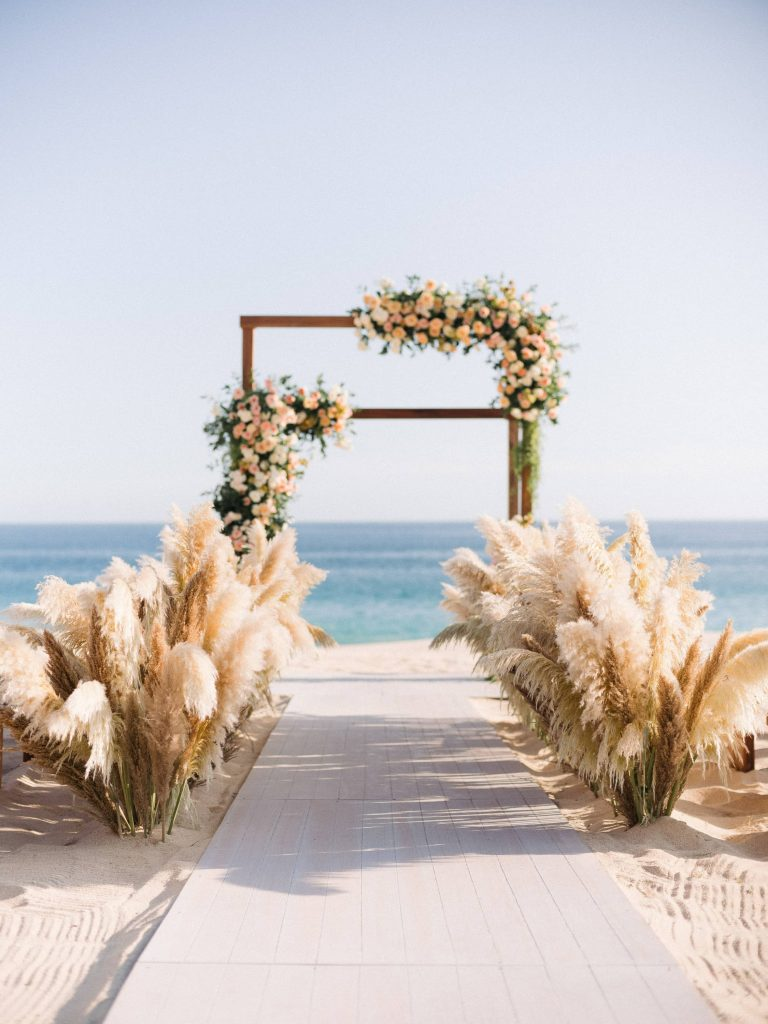 Beautiful ceremony on the beach at this Los Cabos wedding in Mexico | Photo by Allan Zepeda