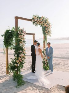 Ceremony on the beach at sunset at this Los Cabos wedding in Mexico | Photo by Allan Zepeda