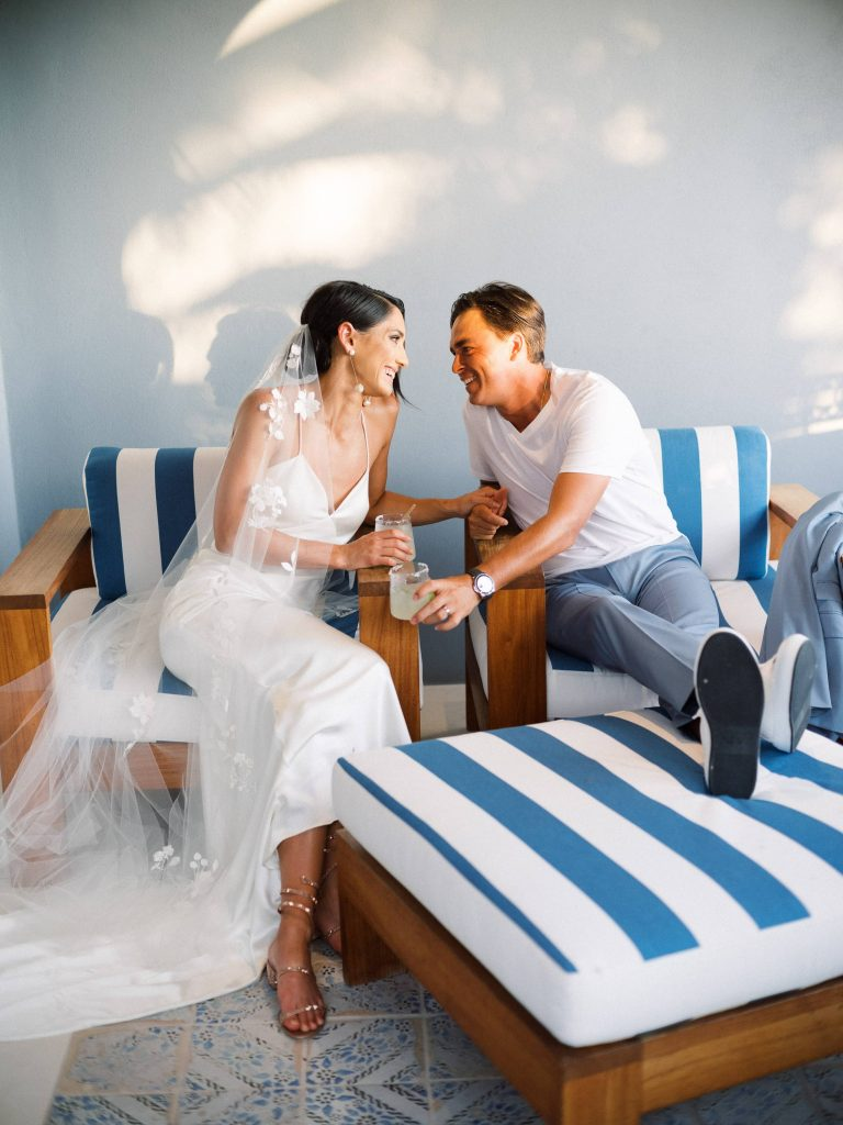 Newlyweds lounging at this Los Cabos wedding in Mexico | Photo by Allan Zepeda