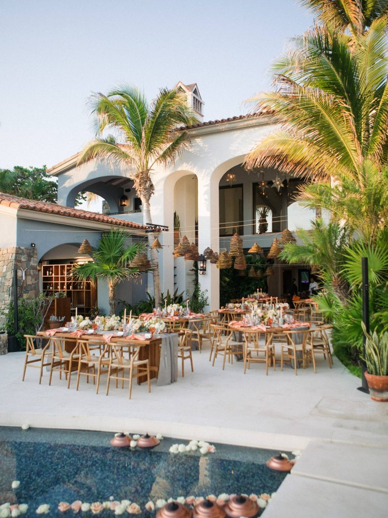 Outdoor reception by the pool at this Los Cabos wedding in Mexico | Photo by Allan Zepeda