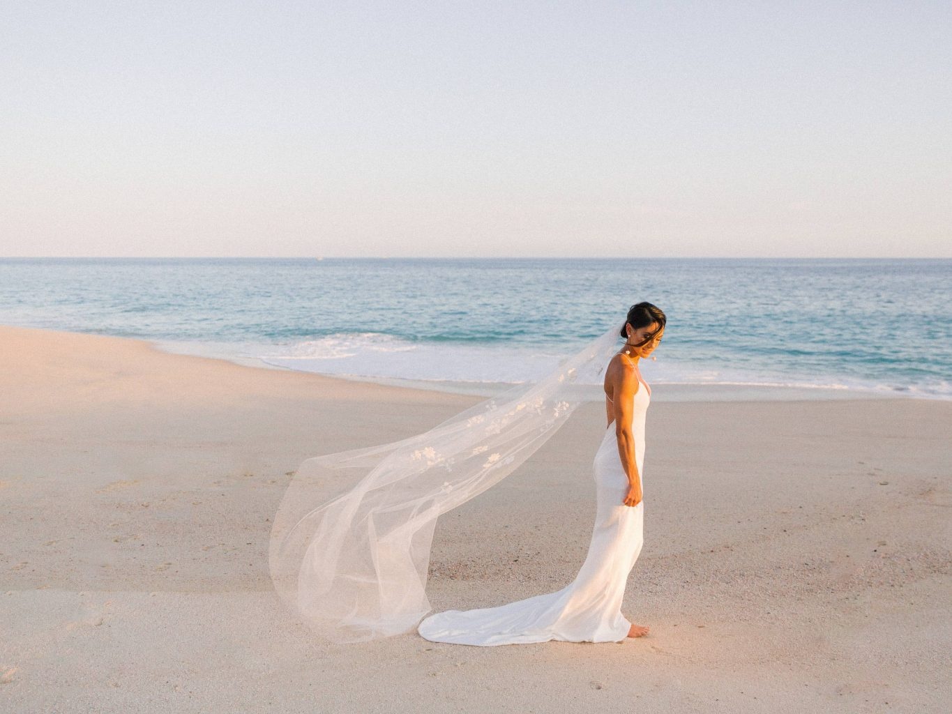 Bride on the beach at this Los Cabos wedding in Mexico | Photo by Allan Zepeda
