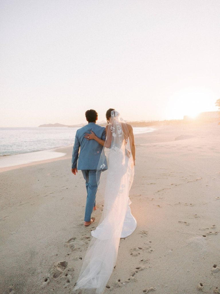 Bride and groom on the beach at sunset at this Los Cabos wedding in Mexico | Photo by Allan Zepeda