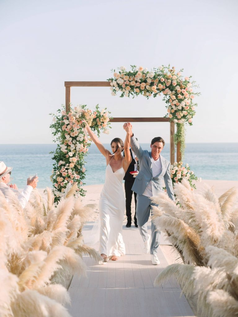 Newlyweds during ceremony at this Los Cabos wedding in Mexico | Photo by Allan Zepeda
