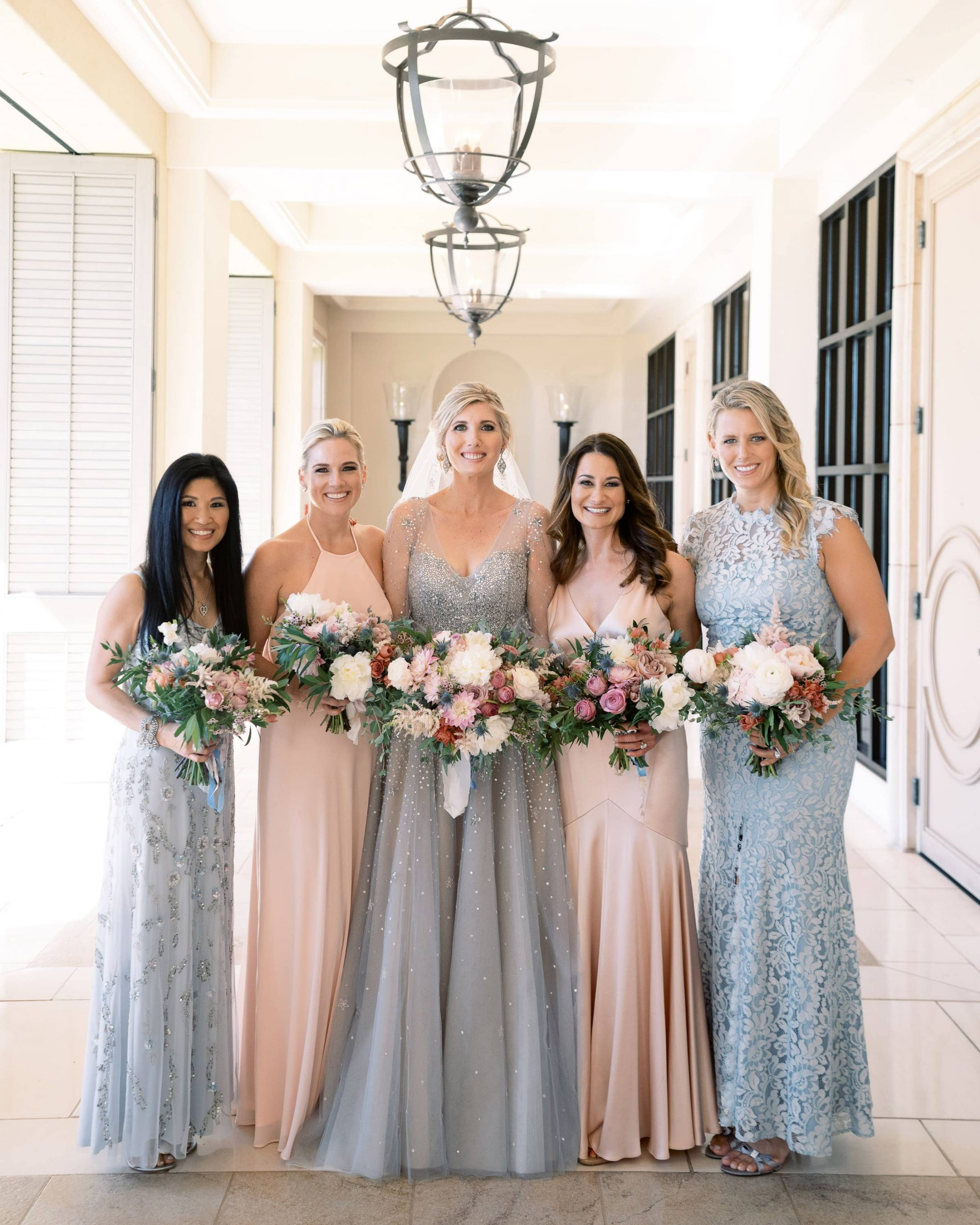 Bride and bridesmaids in light pink and blue dresses at Maui wedding at Four Seasons Resort Maui in Wailea, Hawaii | Photo by James x Schulze