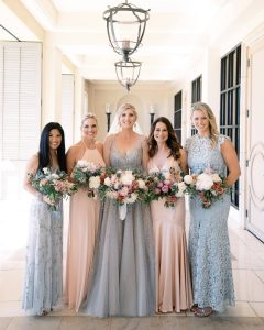 Bride and bridesmaids in light pink and blue dresses at Maui wedding at Four Seasons Resort Maui in Wailea, Hawaii   Photo by James x Schulze
