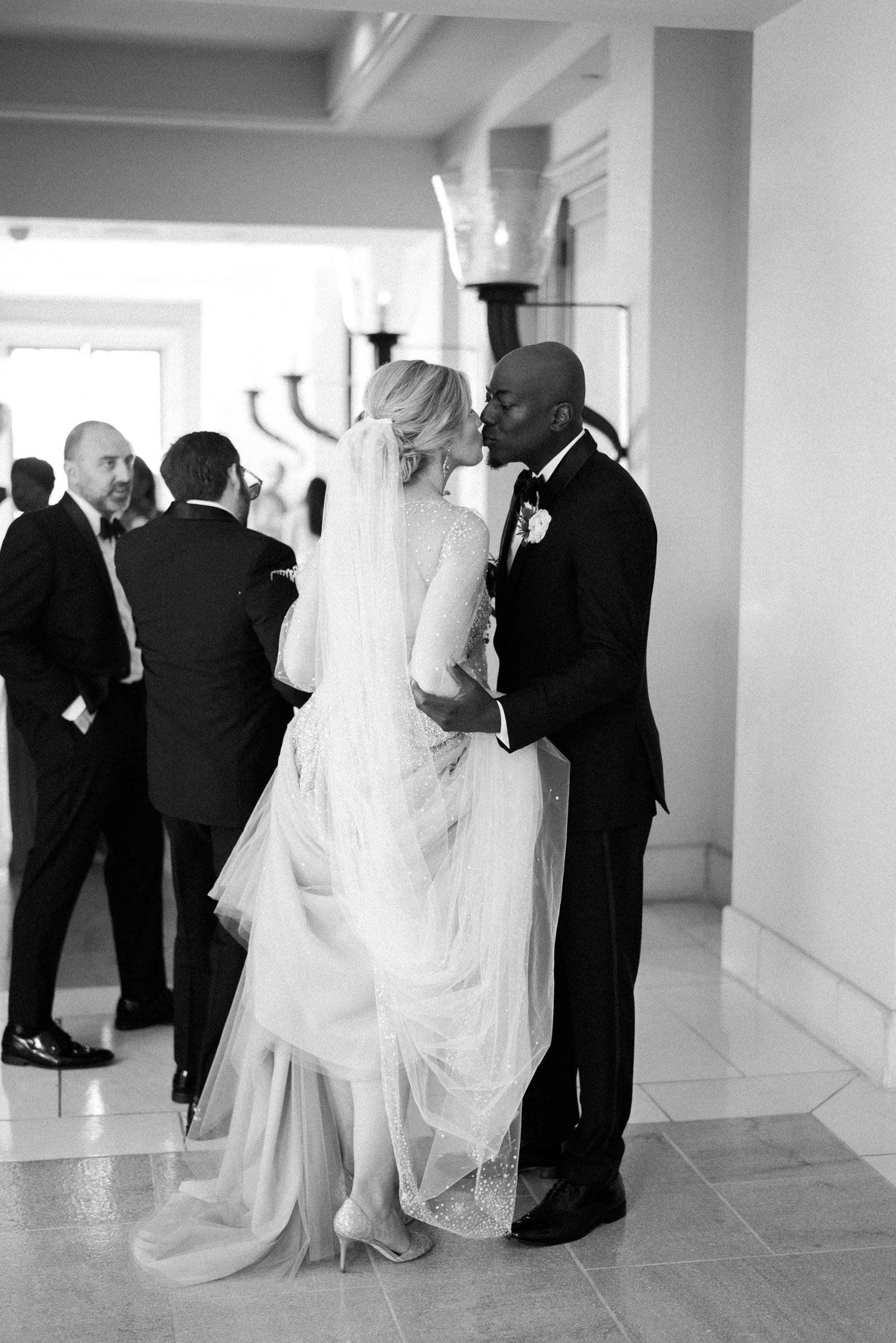 Bride and groom kiss at Maui wedding at Four Seasons Resort Maui in Wailea, Hawaii | Photo by James x Schulze
