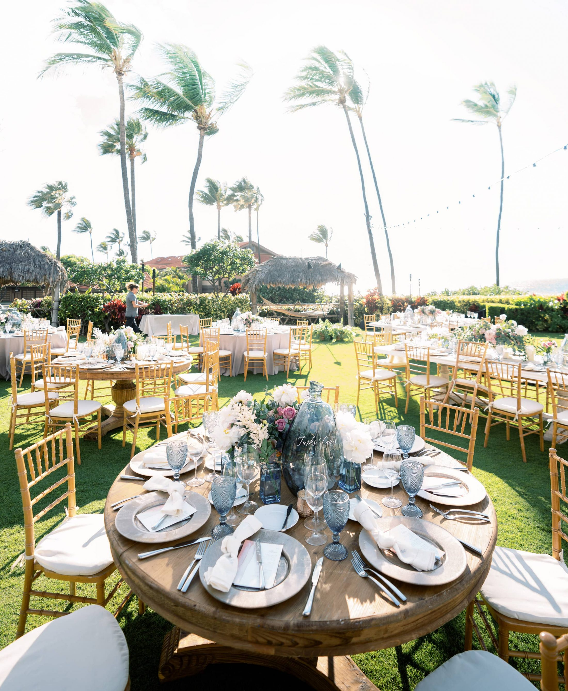 Outdoor reception under palm trees at Maui wedding at Four Seasons Resort Maui in Wailea, Hawaii | Photo by James x Schulze