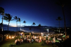 Reception at night under twinkling lights at Maui wedding at Four Seasons Resort Maui in Wailea, Hawaii | Photo by James x Schulze