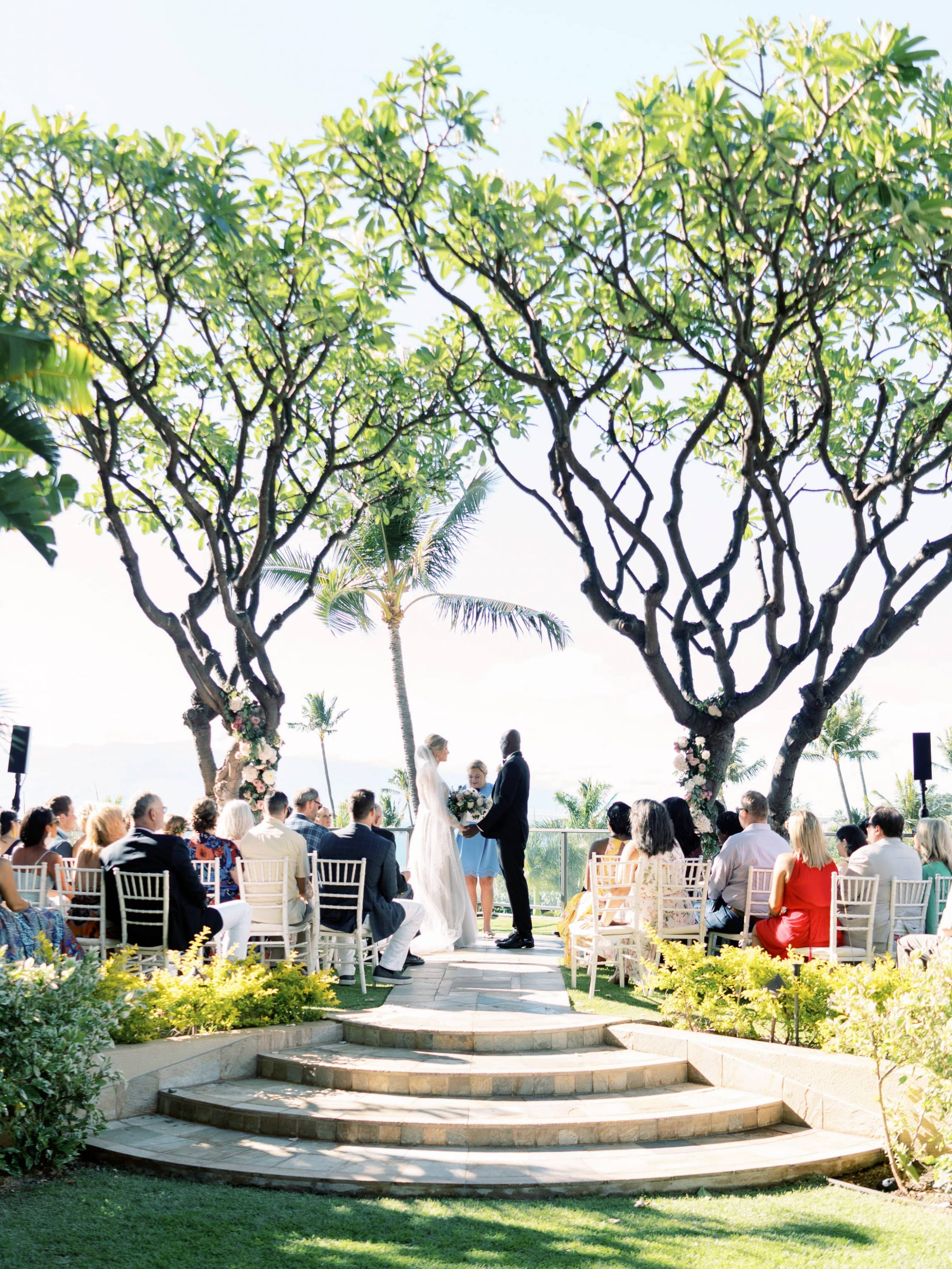 Bride and groom making their vows during the ceremony at Maui wedding at Four Seasons Resort Maui in Wailea, Hawaii | Photo by James x Schulze